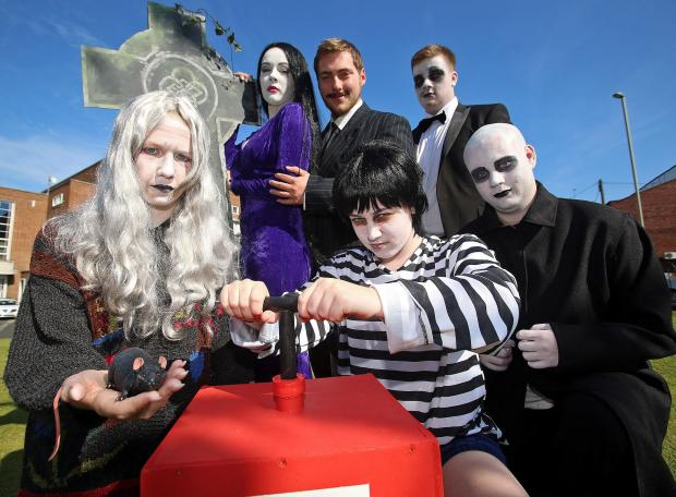 L-r - back Katelyn Laws, aged 16, as Morticia, Tom Dallaway, aged 20, as Gomez, Josh Bennett , aged 17, as Lurch; front -  Megan Luckins, aged 16, as Grandma, Lauren Homer, aged 15, as Pugsley, James Lawley, aged 20, as Fester. Buy photo: 291413J
