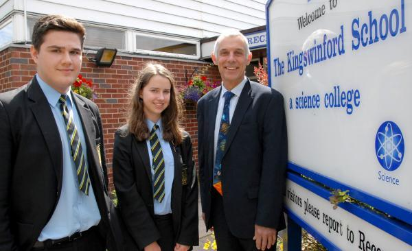 Stourbridge News: The Kingswinford School pupils Liam Evans (15) and Lucy Jones (14), with retiring teacher Mike Davies. Buy photo: 291431M.