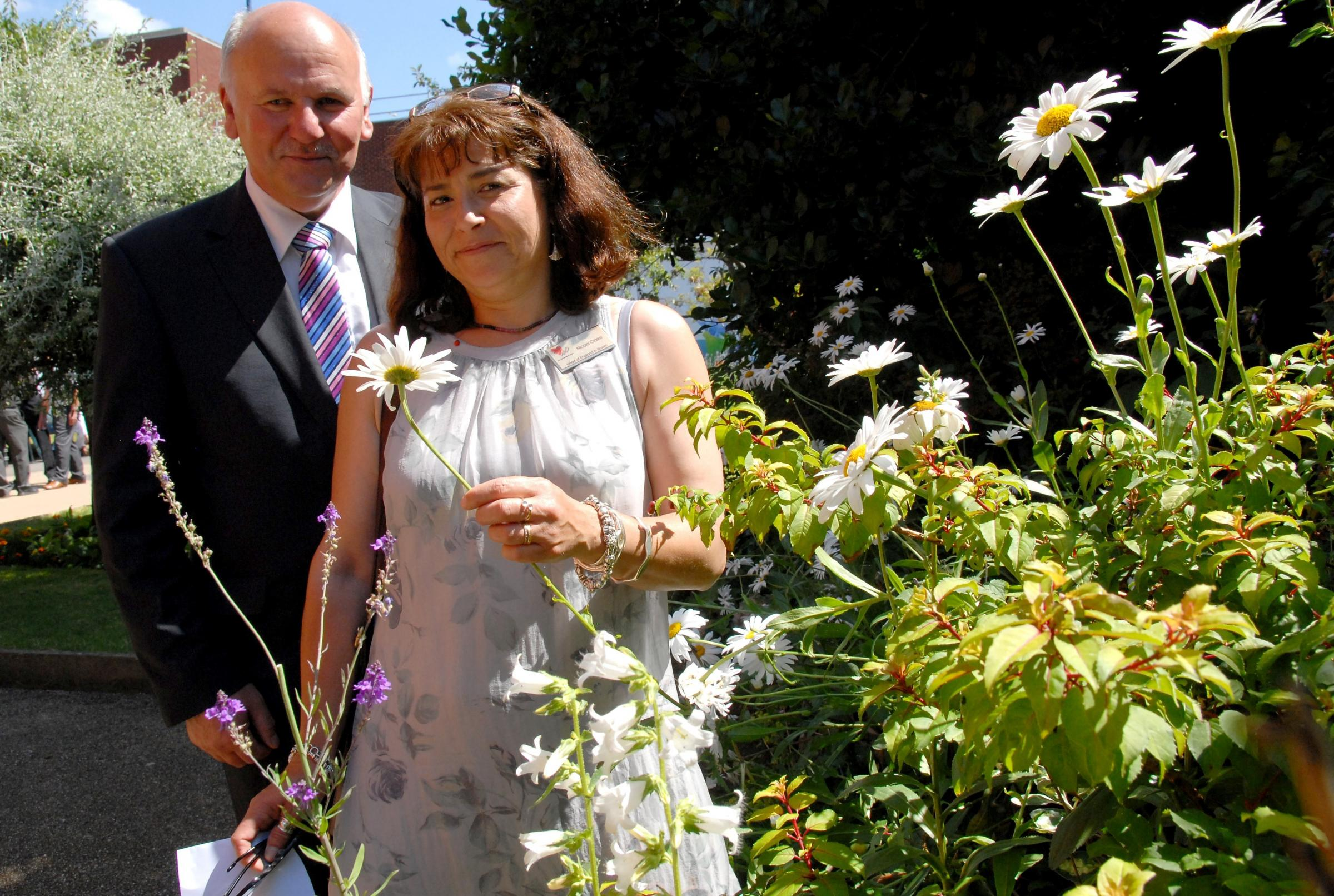 Left to right - Stourbridge in Bloom co-ordinator David Harcourt and Heart of England in Bloom judge Nicola Clarke. Buy photo: 301402M