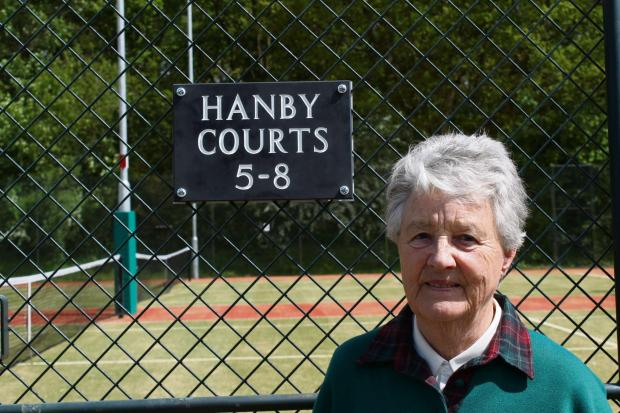 Janet Hanby by the new courts named after her late husband Len. Pic by Dave Tranter
