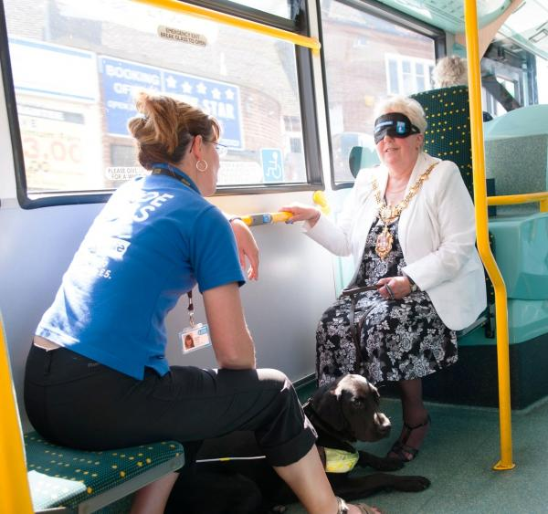 Rachel Baker from Guide Dogs with Cllr Margaret Aston as she experienced a bus journey without the ability to see