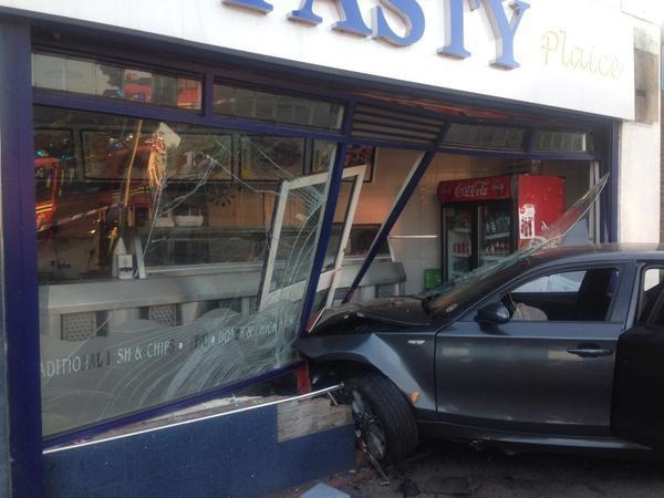 The BMW smashed into the front of the chippy. Photograph by @FireBrierley.