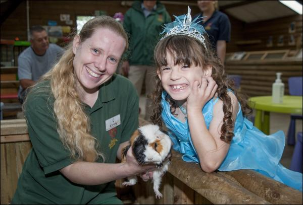 Senior keeper, Kirsty Thornton, introduces Holly Foley to her adopted guinea pig, Rapunzel.