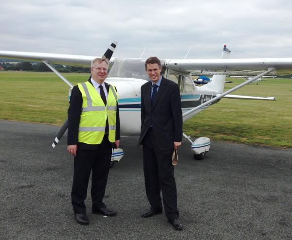 South Staffordshire MP Gavin Williamson at Halfpenny Green Airport, right, with airport operations manager Alastair Mackinnon, left.