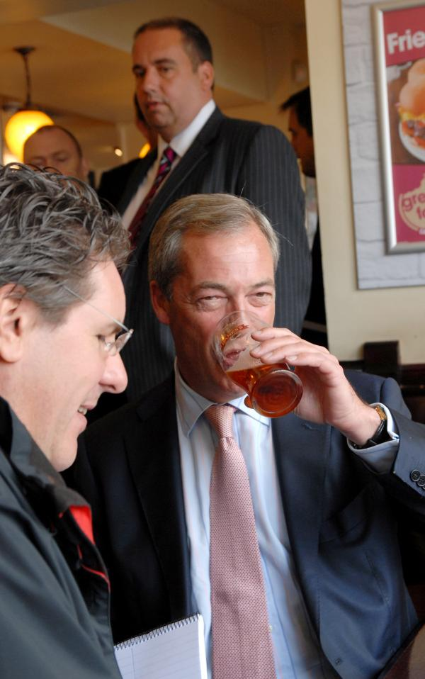First glass - UKIP leader Nigel Farage takes a drink after h-aleing his Dudley MEP Bill Etheridge as his kind of politician