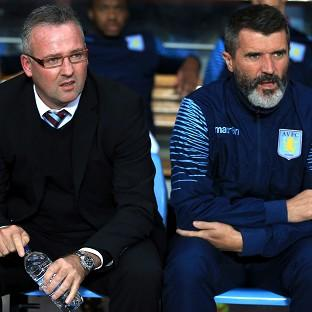 Paul Lambert, left, saw his side humbled