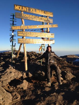 Ben Boleyn at the top of Mount Kilimanjaro
