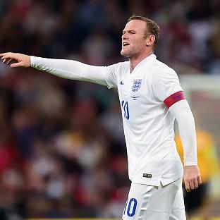 Paul Scholes would move Wayne Rooney, pictured, into midfield for England