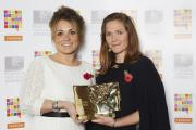 Kerry Poole receiving her teaching award from actress Jessica Hynes.