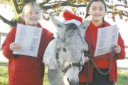In happier times: Emily and Maisie Sproule with Kenny the donkey in 2009.