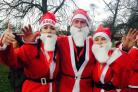 Mary Stevens Hospice's festive fundraisers Rachel Finlayson, Barry Finlayson and Claire Parslow at last year's Santa Jog