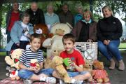 Thomas, 8, and Harry Sparks, 6, with members of the Friends of Quarry Bank Park group getting ready for their teddy bears picnic.