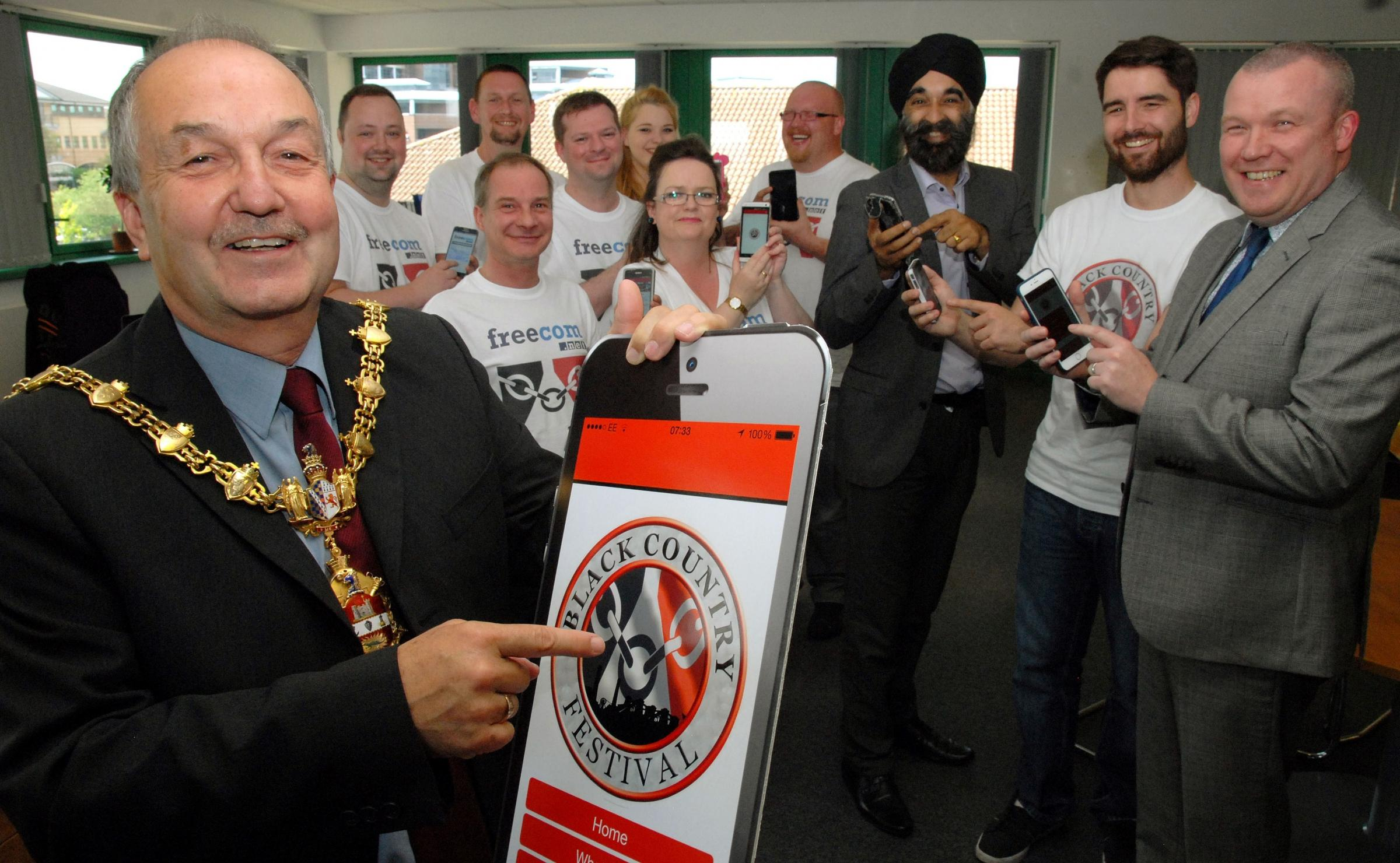 Mayor cllr Steve Waltho with, from right, Freecom dire3ctor Mike Geer, Steve Edwards - Black Country Festival, Ninder Johal - Black Country Chamber of Commerce, and staff at Freecom.