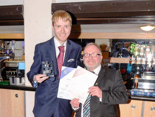 Former King Edward VI pupil Philp Brookes receiving his award from the University of Worcester's John Ryan.