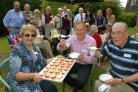 Wayne Barker, centre, with Pat Hill, John Pedlingham and other residents at the estate's summer fete.