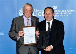 Rob Chadwick, director of The ContinU Trust, right, receiving the community champion award from West Mercia Police and Crime Commissioner Bill Longmore