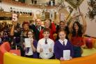Back l-r Michelle Watson, Dudley Mayor Cllr Steve Waltho, Mayoress Jayne Waltho, Liz Taylor (general manager at intu Merry Hill) and Chiara Glorioso (host).Front l-r winners Grace Harris, Connor Harris and Olivia Wood. Pic by Shaun Fellows/ShinePix