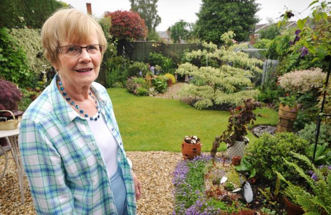 mary tromans in her back garden at 70 churchview gardens kinver