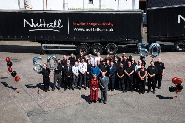 Alan Nuttall with staff with over 20 years' service