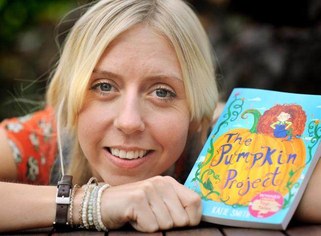 Katie Smith with her book The Pumpkin Project