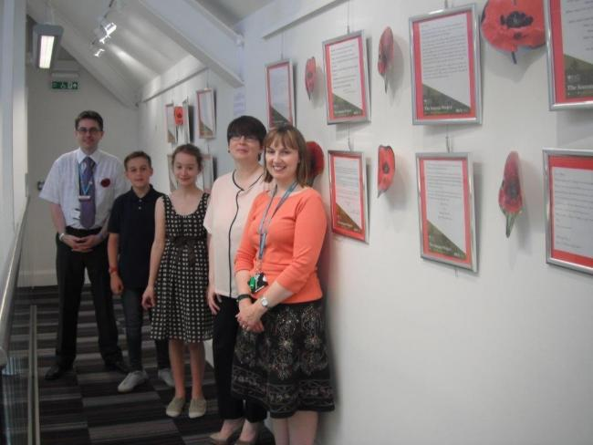 TRIBUTE: James Robertson (Warndon Library), Thomas, 13 years old, and Isobel, 12 years old, pupils at Pershore High School, Naomi Flannagan (librarian, Pershore High school) and Emma Powell (Pershore library manager) with the display at Pershore Library