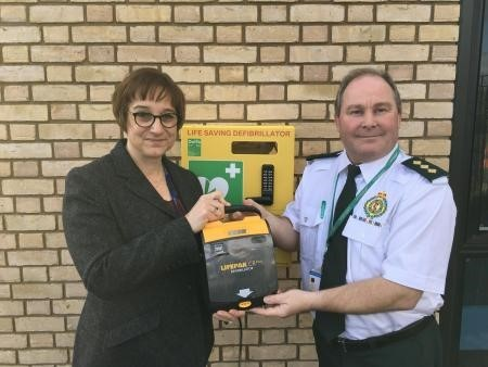 College principal Remley Mann and Andy Jeynes, of West Midlands Ambulance Service, with the newly installed defibrillator. Photo: King Edward VI College