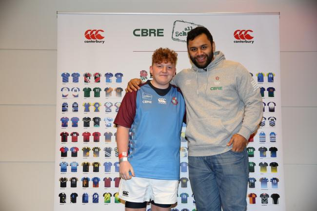 Crestwood School pupil Lewis Brett unveiled his school's new rugby kit at the England v Italy 6 Nations tie at Twickenham, alongside England international Billy Vunipola. Photo: Sportsbeat