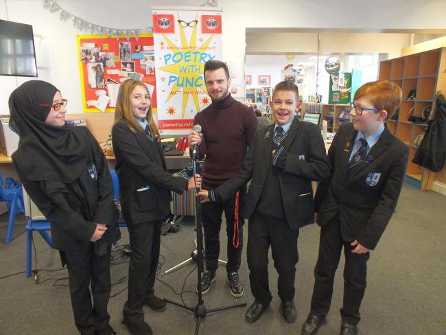 Year seven students l-r - Nafisah Usman, Olivia Tennant, Jack Goode, Zak White with poet Matt Windle, centre.
