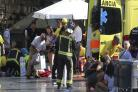 Paramedics tend to the injured in Barcelona.