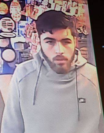Dudley Police have released this CCTV image of a man they are trying to trace in connection with a bank card theft.