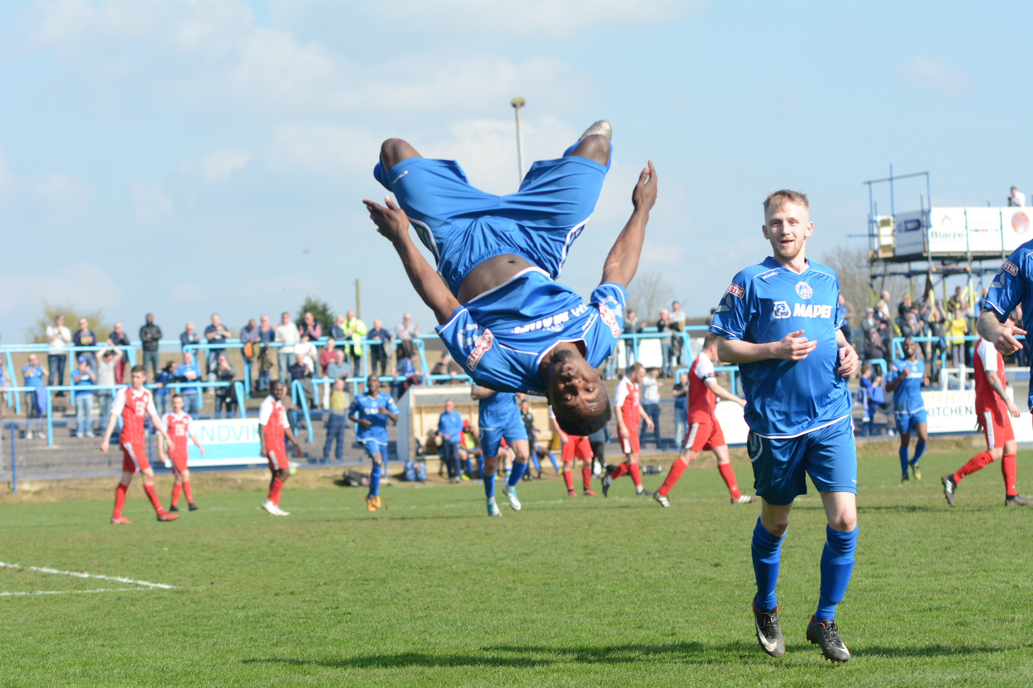 Roland Agbor celebrates his goal against Ashton in spectacular style. Photo courtesy of Halesowen Town