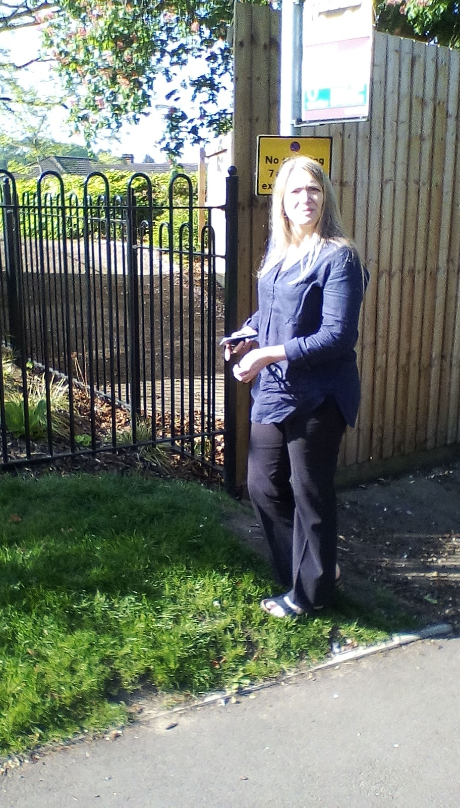 Cllr Rachel Jenkins next to the blocked footpath