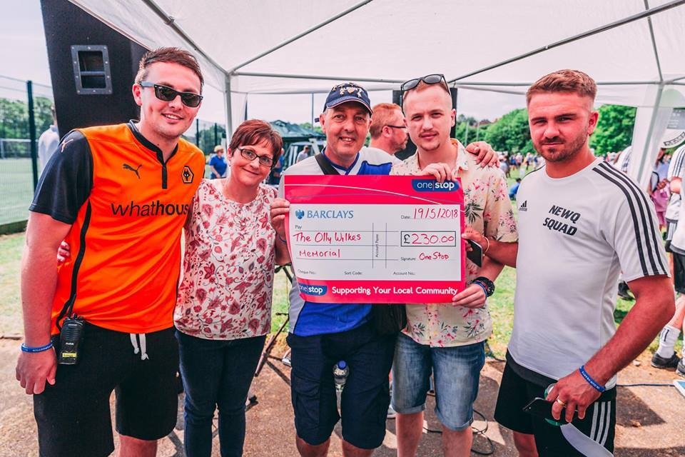 Left to right: Olly's brother Ben, mother Lynn and father Simon with Luke Gorton from One Stop and Olly's friend Joel Fullwood with one of the many donations made on the day. Pictures by Ben Jancso and JM Photography.