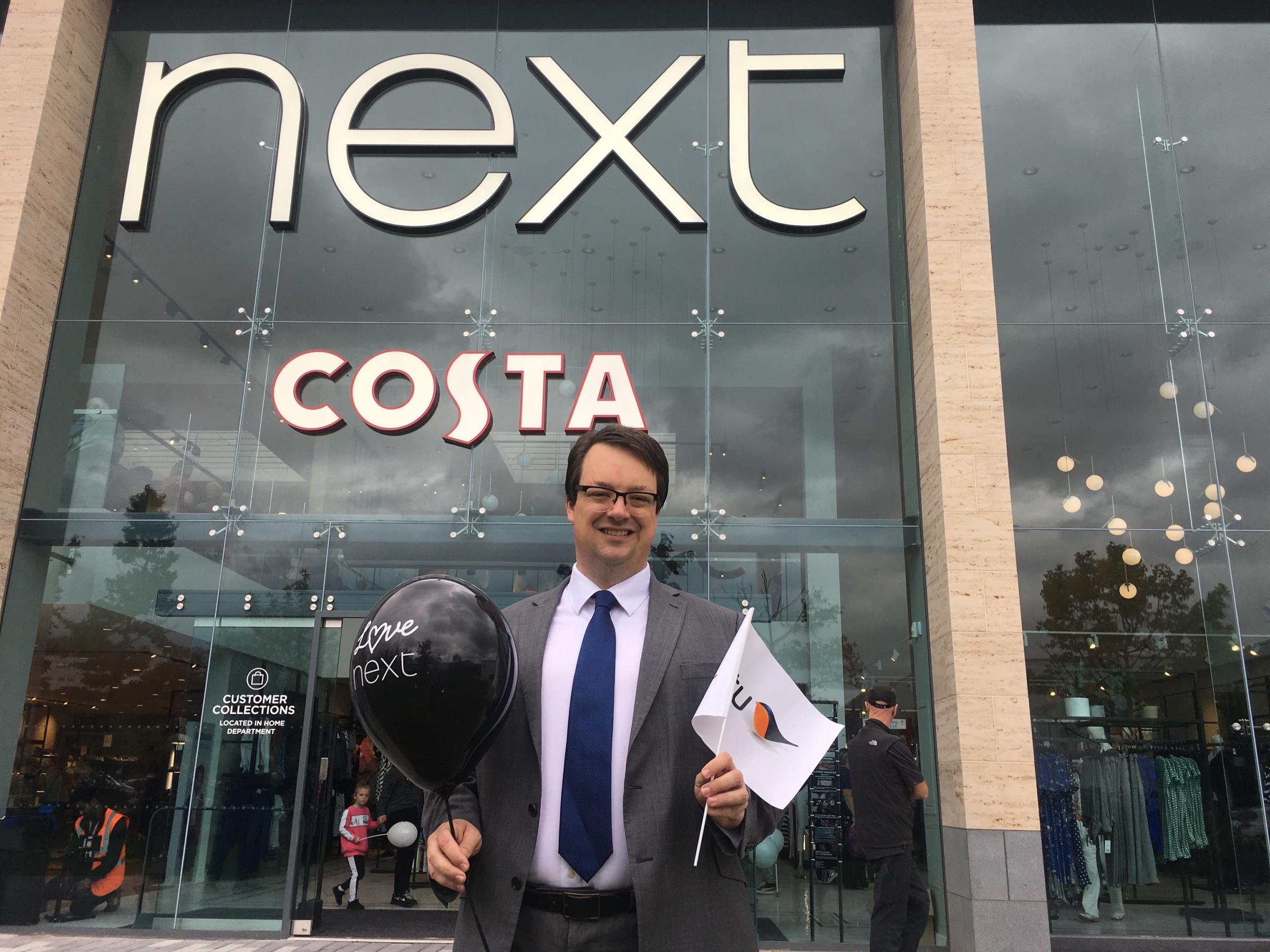 Dudley South MP Mike Wood outside the new Next store