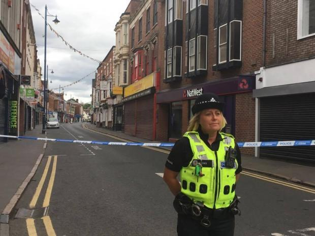 A police officer in Stourbridge High Street after the tragic stabbing of Ryan Passey who died after being attacked at Chicago's nightspot in August 2017