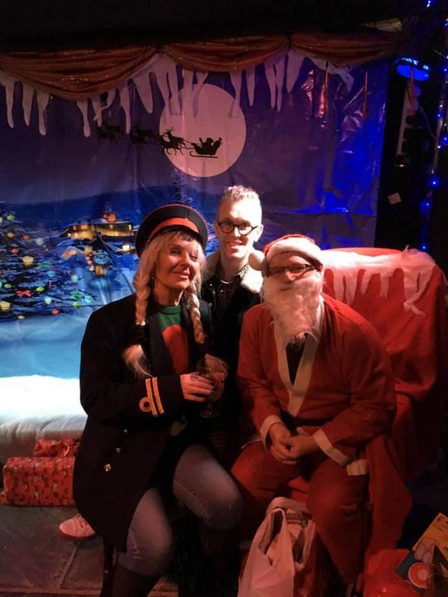 Trina Keane, co-owner of Katie Fitzgerald's, and barman Jamie Ward, with councillor Pete Lowe standing in as Santa Claus at the Operation Santa Christmas appeal