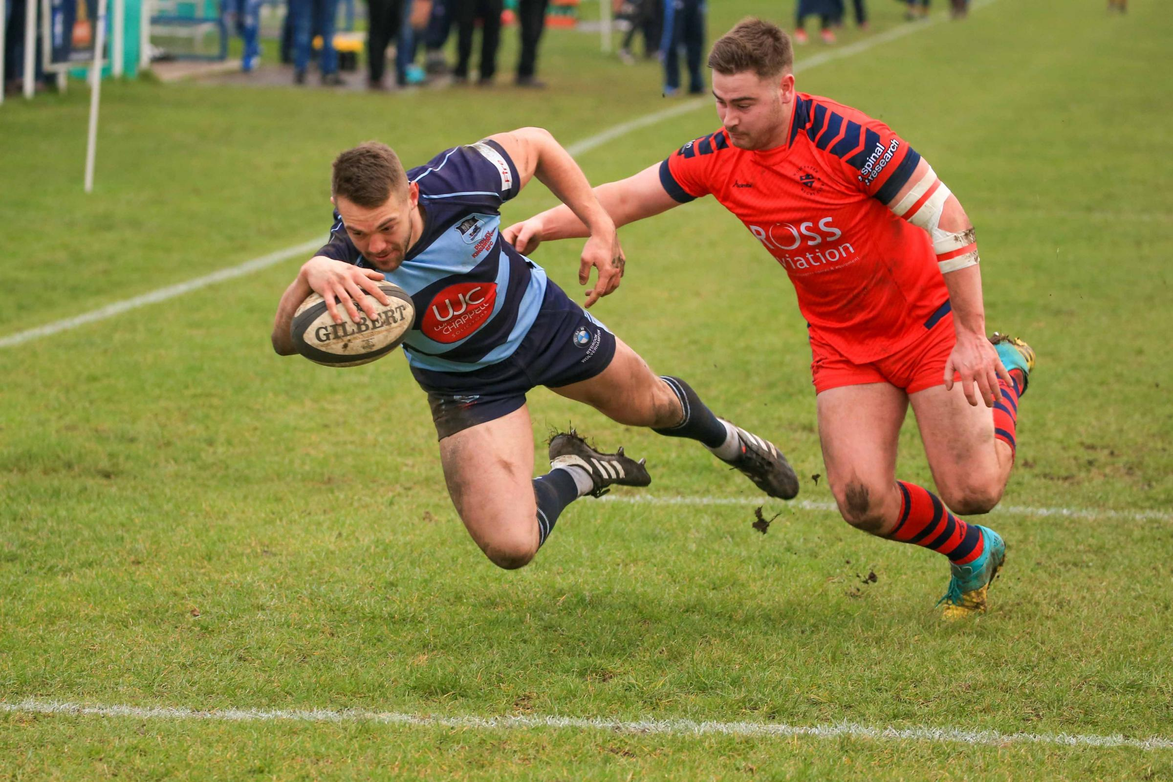 Stefan Shillingford scores for DK. Photo: Ian Jackson