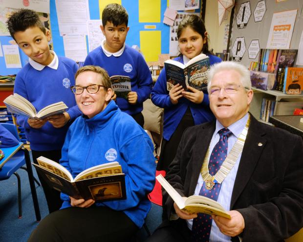 Stourbridge News: Headteacher Jo Quigley with Andrew Scudamore, president of Stourbridge Rotary Club, with class five pupils Amaan Ahmed, Adam Kaiser and Haleema Sahdia
