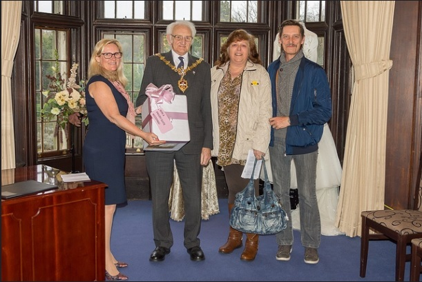 Penny Fulford, superintendent registrar, The Mayor of Dudley councillor Alan Taylor with happy wedding winners Wendy Toy and Simon Kelly.