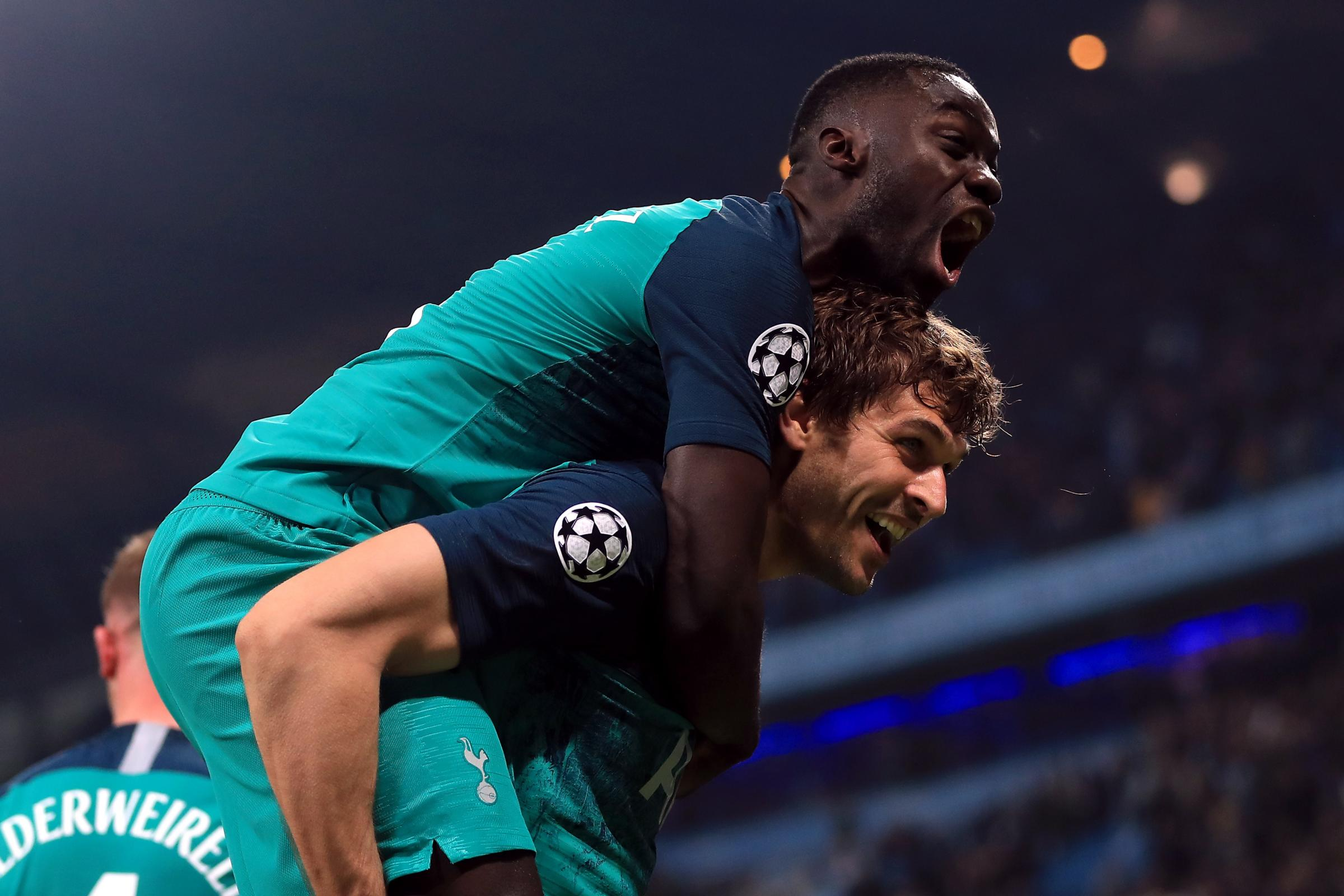 Fernando Llorente and Davinson Sanchez celebrate Spurs' incredible victory over Manchester City