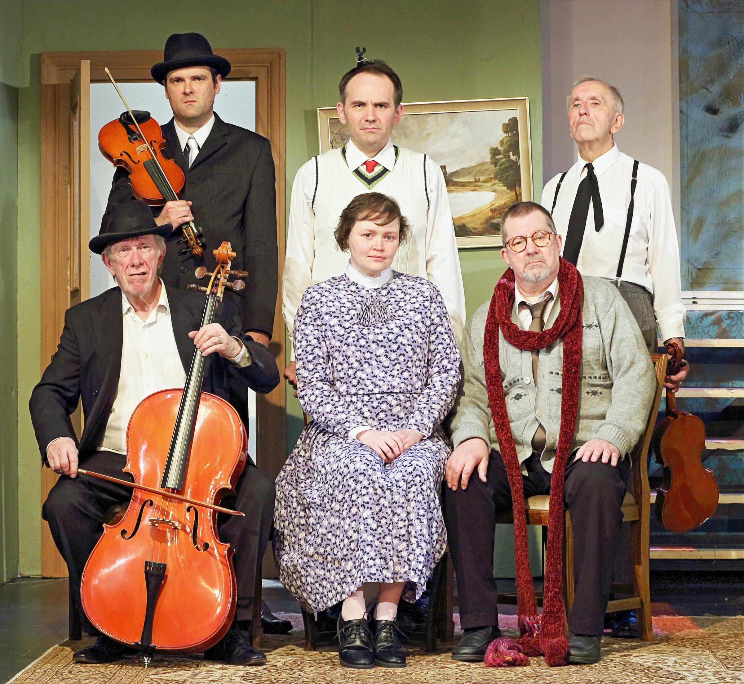 L-r (standing) Gareth May as Louis, James Silvers as Harry, Maurice Felton as Major Courtney, (seated) John Lucock as One Round, Claire Hetherington as Mrs Wilberforce, Tony Stamp as Professor Marcus.