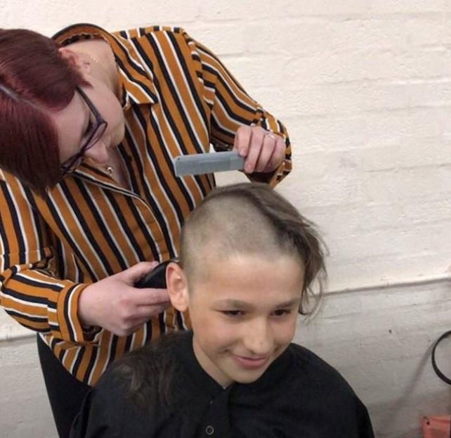 Tom Farmer, 13, braves the shave for cancer research from stylist Natalie Cox. Picture: Farmer family